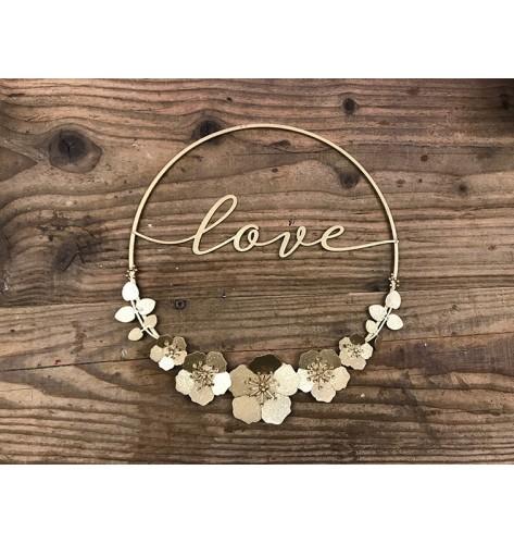 """Cerchio in metallo color oro glitterato, con scritta """"Love"""""""
